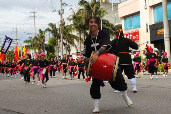girl beating japanese drum in festival parade