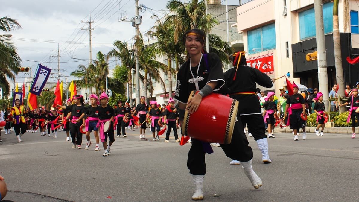 girl beating japanese drum in festival parade